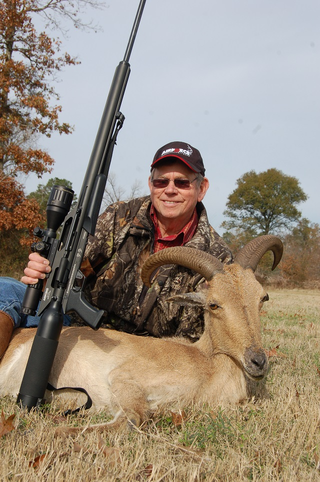 Hunter with Gun and Deer